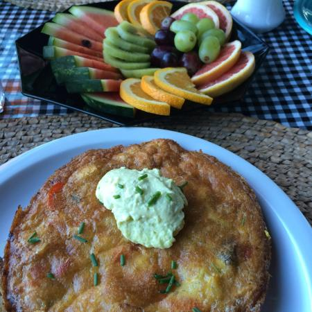 Nahcotta, WA: Scrumptious veggie frittata with fruit for breakfast made from home grown eggs