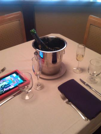 Crossings At The Riverhouse: bottle of champagne kept cold at a great price