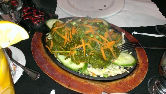 India Village Restaurant: Sizzling platter of lamb.