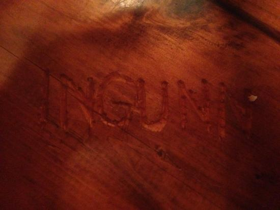 Camp Bar & Restaurant: Racial slur carved into our table with resin over it!!!!!! Gross