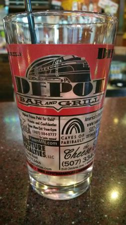 Depot Bar & Grill: Local biz ads on glass.