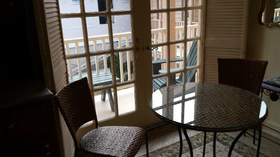 The Old Brick Inn: Table in the kitchen and view of back balcony