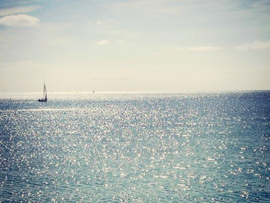 Yacht on the English Channel looking out from sunny Brighton Beach