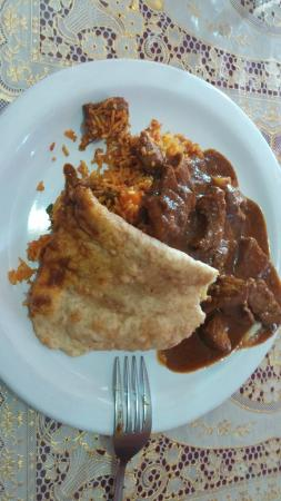 Madhuban Indian Cuisine: Curry goat with fried rice