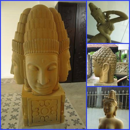 Vina Hotel Hue: Ancient statues add a little interest to the hotel entrance and lobby.
