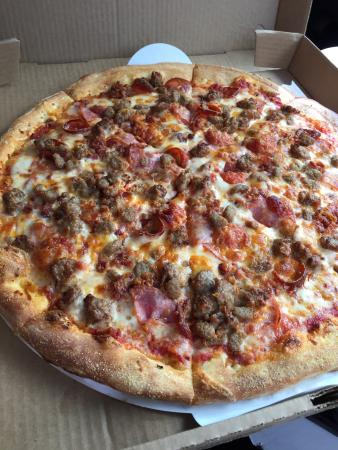Pauly's Pizzeria & Sub Co.: Pauly's Meaty Large thin crust pizza! Yum!!