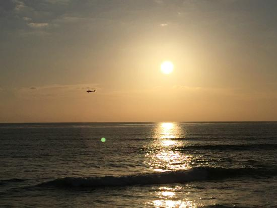 """La Jolla Beach Travelodge: The local """"WindAnSea Beach""""  sunset with helicopter"""