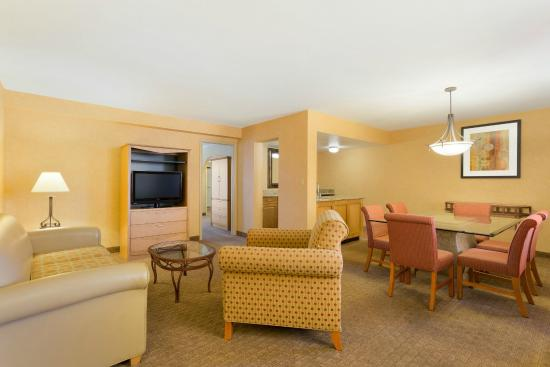 Embassy Suites by Hilton Phoenix Airport: The Executive King Suite offers extra space, a conference table and private sleeping area.