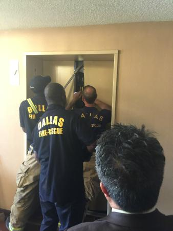 Sheraton Suites Market Center: Being rescued by Fire Dept from unsafe elevator!