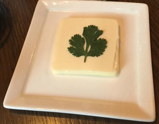 Fuego Restaurant: Large pat of butter decorated with cilantro.  Nice touch.