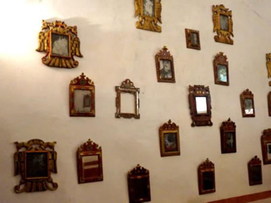 Room off of the Santa Ana Zegache church houses walls of mirrors used in the past to increase li