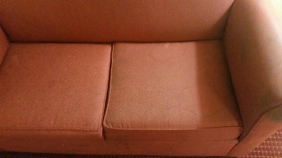 Days Inn Mount Hope: These pictures don't even do it justice. This was literally the most disgusting couch I've ever