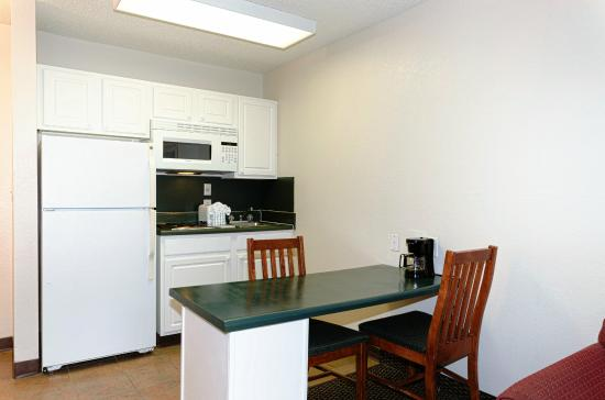In-Town Suites - Crestwood Suites Fort Myers: Full size refrigerator in each suite