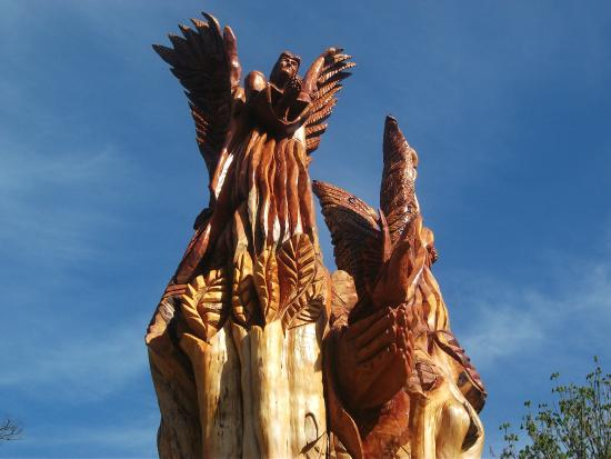 Copper Coast Geopark Visitor Centre: The 'Angel of Fenor' carved by local chainsaw artist John Hayes from a storm damaged tree.