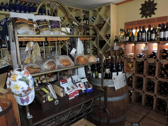 Basic Necessities: LOVE the decor............cool gift shoppe, handpainted hats/wine/cheese/fresh bread