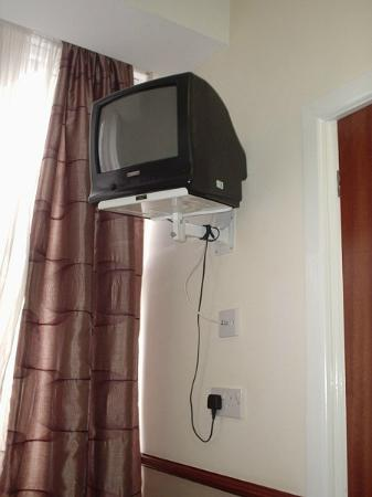 Palm Court Hotel: TV in Bedroom