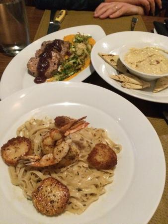 Flint: Seafood linguini, hummus appetizer, and pork loin entree. Everything was delicious!