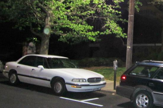 Haunted Asheville Ghost Tours: Taken on Church St.  Notice the large greenish-yellow orb, and someone behind the sign...