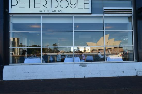 Peter Doyle @ The Quay: a reflection of the Opera House captured on the window where we are seated.