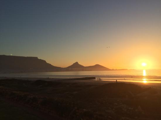Cape Town Beachfront Apartments at Leisure Bay : Sunset amongst the hills and the Ocean from the room!
