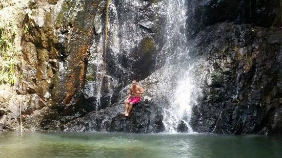 Tak Tak Falls: Me sitting in the waterfall