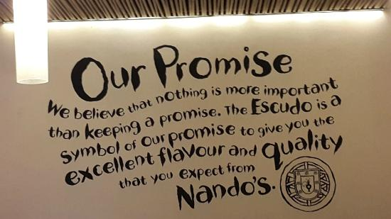 Nando's : Their promise written at the entrance.