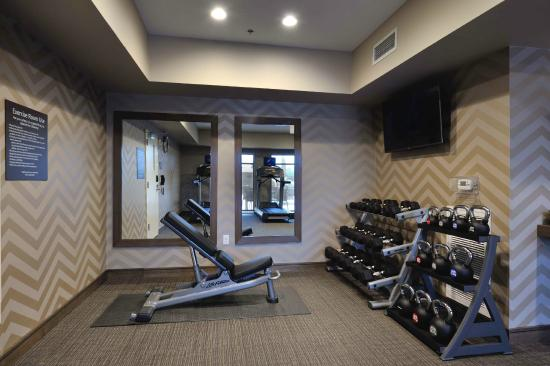 Full set of weights in gym picture of residence inn houston