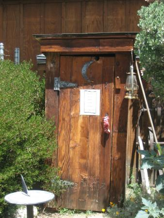 The Kern Valley Museum : The outhouse. The sign says to knock before entering. That's good advice.