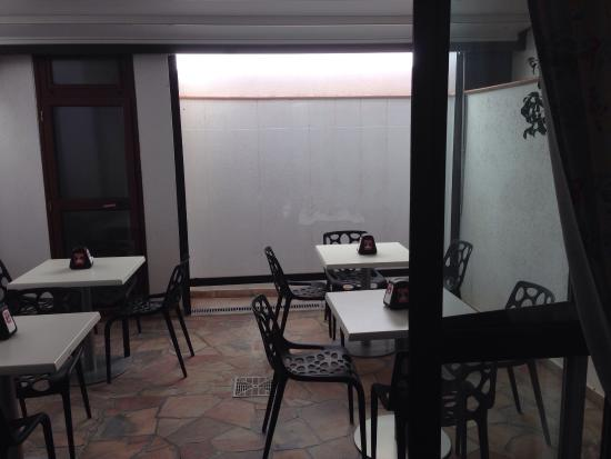 """Hotel Aliai : The """"lovely"""" courtyard where breakfast is served. I guess people have different ideas of lovely."""