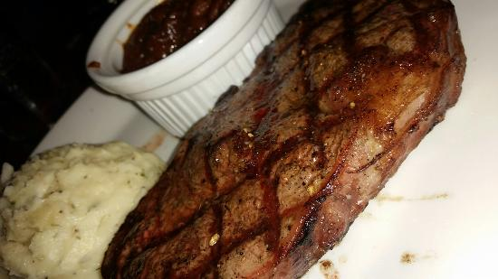 Austin's Restaurant & Bar: Strip steak, meaty baked beans and whipped garlic mashed potatos