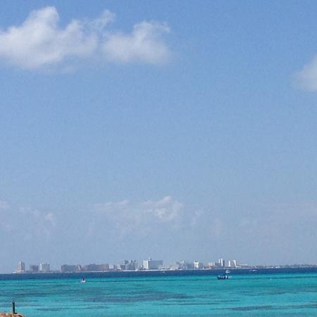 Maria's Kan-kin: View of Cancun across the water.