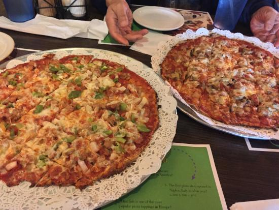 "Wells Brothers Italian Restaurant : Two ""special"" sized pizzas for four."