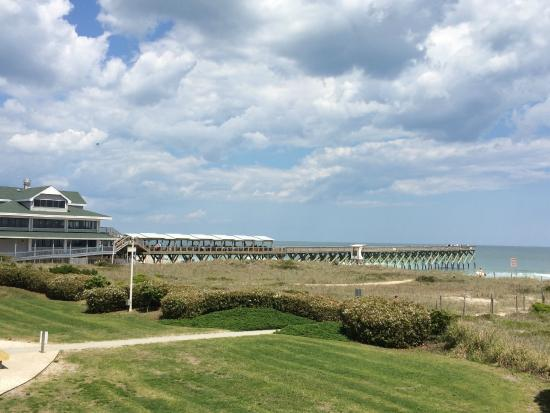 Surf Suites Motel: View of the restaurant and pier next to property