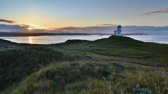 Sunrise over the lighthouse at Cattle Point