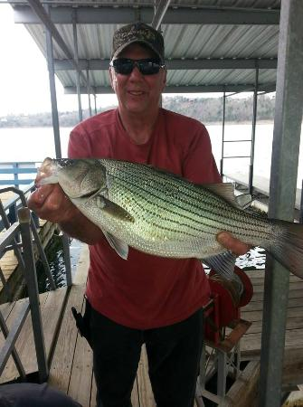 Blue Lady Resort and Sunset Grill: Happy guest with a striper