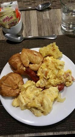 My free buffet breakfast of Scrambled eggs (2 different ways) Smokey links sausages, Mini Croiss