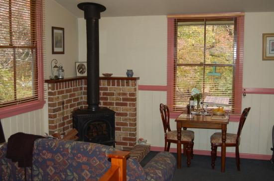 Secrets Hideaway: The living area and wood-burning stove (very efficient) at Secrets Maid's quarters.