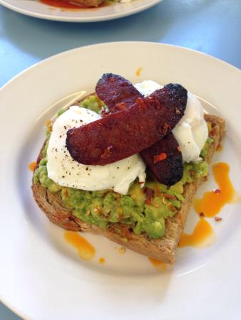 Smashed avocado, poached eggs and chorizo on toast. - Picture of ...
