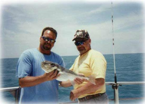 danny with a flounder and key west grunt foto di captain ForCaptain Tonys Fishing