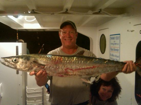 Kevin with a nice kingfish caught on night trip foto di for Captain tonys fishing