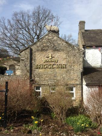 The Bridge Inn: Sheep with unicycle on roof. A pub with a sense of humour