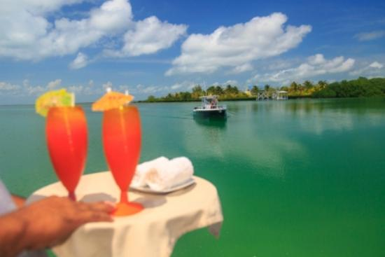 St. George's Caye Resort: Private boat ride to the island and welcome drinks included