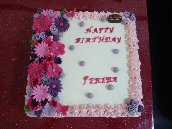 Fresh cream cake with fondant flowers. - Picture of Delicious Dessert ...