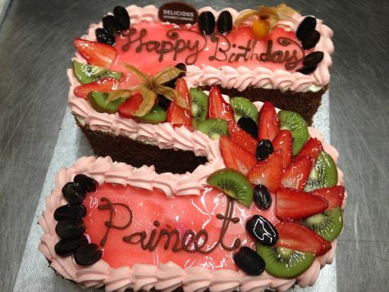 Fresh cream cake with pink glaze and fresh fruit Picture of
