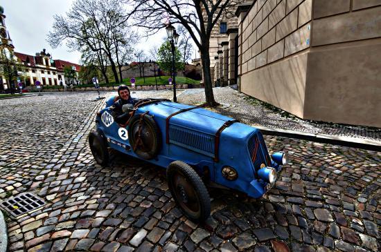 Prague Photo Tours: Classic Race car on Cobblestone street near Prague Castle