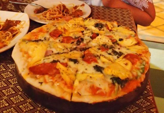 Medium, happy, ecstatic pizza