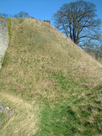 Pickering Castle: The full height of the motte - from the bottom of the ditch to the top of the motte.