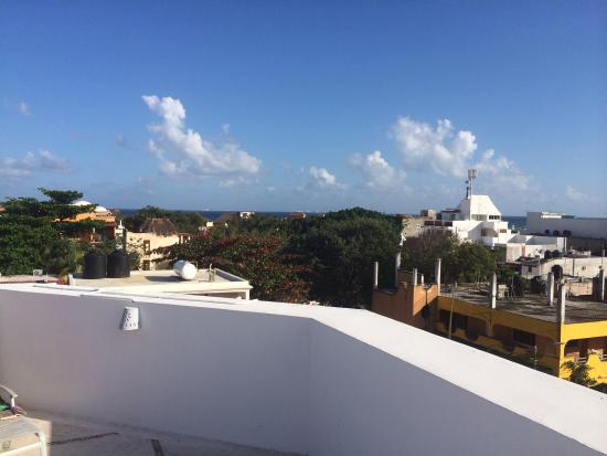Los Itzaes Hotel: You can barely see the ocean from the rooftop pool area, but it's just about a 2min walk away.