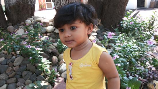 Gateway Retreat Sanchi: Amazed baby in the garden