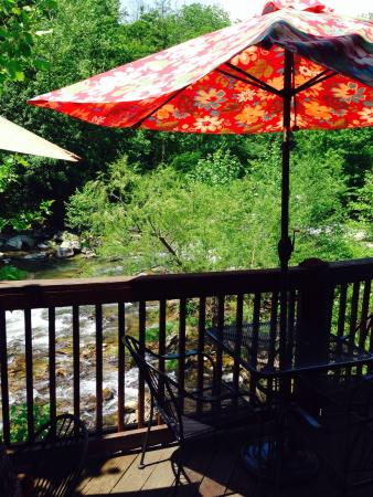 Tia B's : Dining on a deck by the mountain stream.